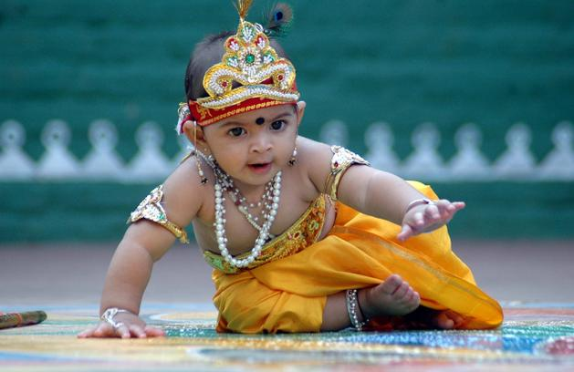 A child dressed as Lord Krishna on the occasion of Janmashtami in Hyderabad