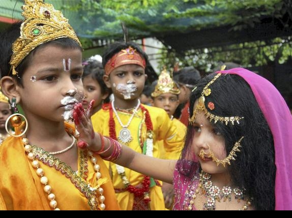 School children dressed as Lord Krishna and Radha celebrate Janmashtami festival in Patna